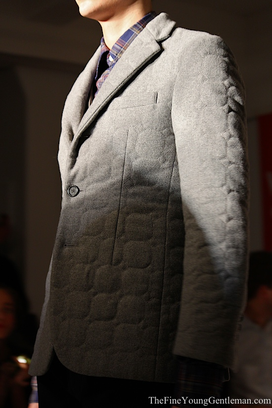 gray quilted sports jacket