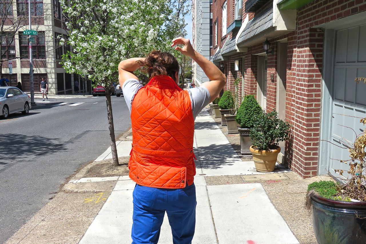 mens spring layering orange vest blue pants