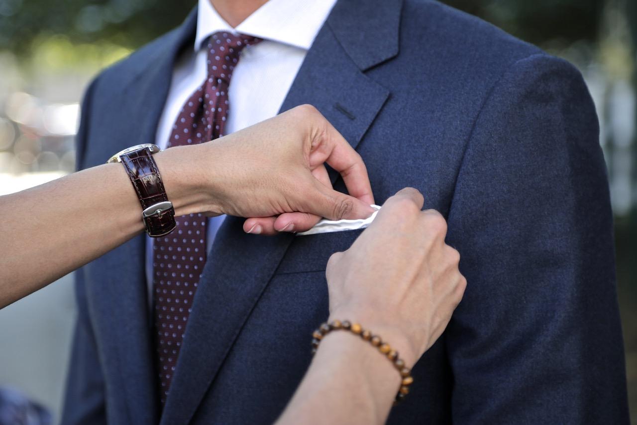 blue flannel suit and pocket square black lapel